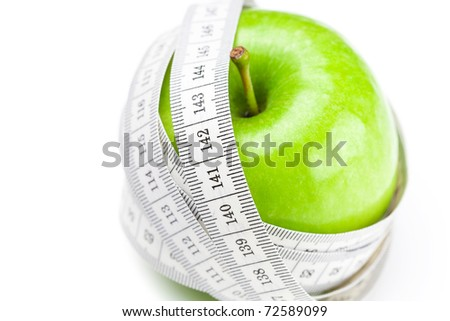 apple and measure tape isolated on white
