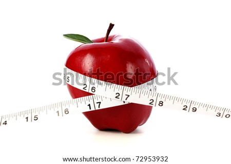 Apple and measuring tape - stock photo