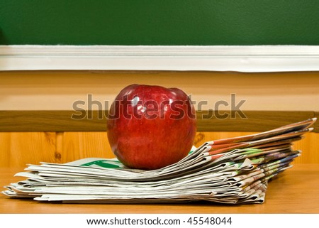apple and newspapers - stock photo