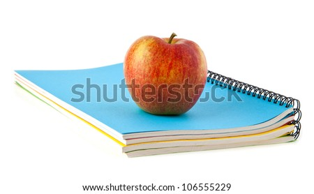 apple and notebooks on a white background - stock photo