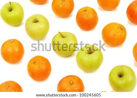 apple and oranges arranged to symbolize leadership, teamwork, network, discrimination............ - stock photo