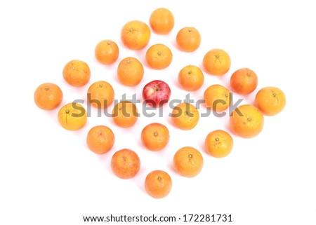 apple and oranges arranged to symbolize leadership, teamwork, network, discrimination. - stock photo