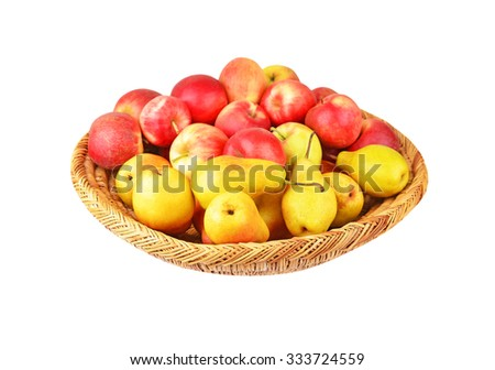 Apple and pear in a wattled basket, isolated on white background
