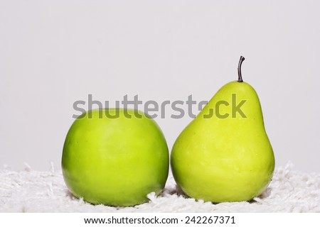 Apple and pear shot in studio - stock photo
