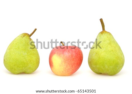 Apple and pears in front of a white studio background