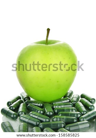 Apple and pills isolated on white background - stock photo