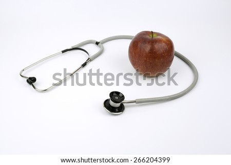 Apple and stetoskop on white background. - stock photo