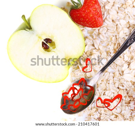 Apple and strawberry with oatmeal and vintage spoon, close up - stock photo