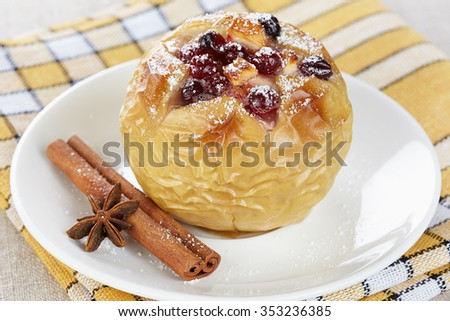 Apple baked with honey and cranberries - stock photo