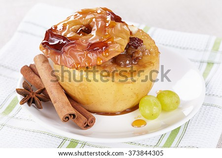 Apple baked with honey, nuts and raisins - stock photo