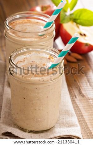 Apple Banana Cinnamon Smoothie in small jars - stock photo