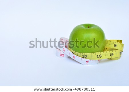 apple bind with tape measure concept lose weight food scale