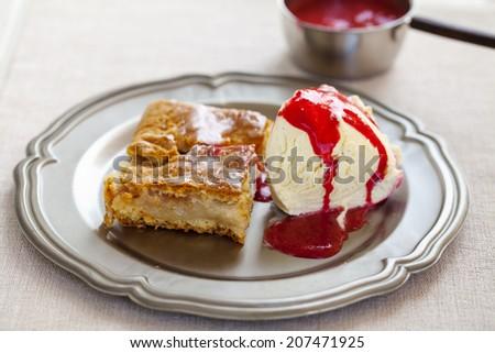 Apple cake with ice cream and raspberry sauce - stock photo