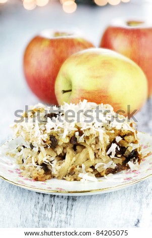 Apple casserole made of shredded apples, oats, coconut and raisins. Shallow depth of field. - stock photo