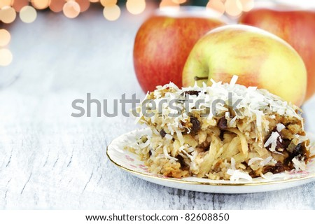 Apple casserole made of shredded apples, oats, coconut and raisins. Shallow depth of field with room for copy space. - stock photo