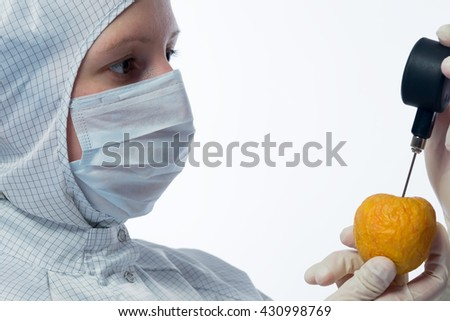 apple check in the hands of the scientist - stock photo