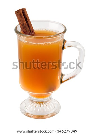 Apple Cider and Cinnamon Stick in a Glass Mug. The image is a cut out, isolated on a white background, with a clipping path. Traditionally served around the holidays. - stock photo