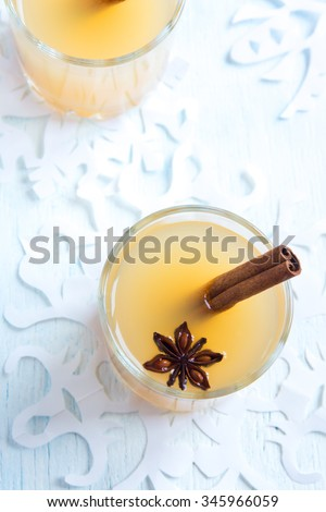 Apple cider rum punch. Hot drink for Christmas and winter holidays. - stock photo