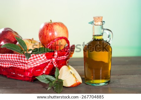 Apple cider vinegar with a fresh apple - stock photo