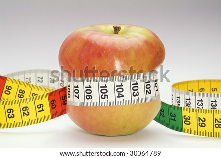 Apple constricted by measuring tape