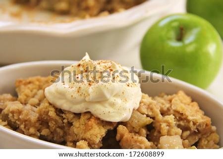 apple crisp upclose whipped cream cinnamon - stock photo