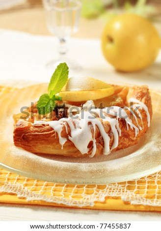 Apple danish pastry with frosting - stock photo