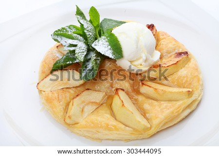 Apple dessert with ice cream and mint