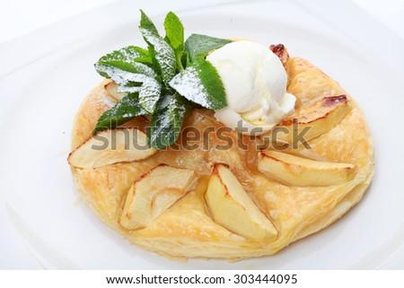 Apple dessert with ice cream and mint - stock photo