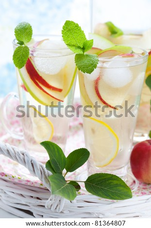 Apple drink with lemon,mint and ice cubes - stock photo