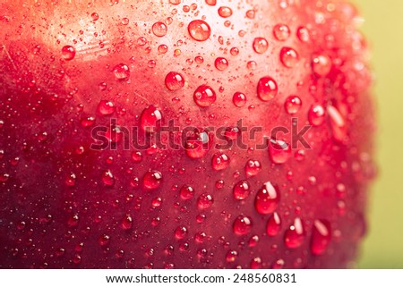 Apple drops on a wet surface. Shallow depth of field - stock photo