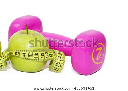 apple, dumbbells and tape measure - stock photo