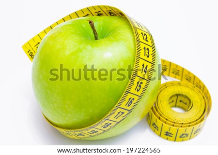 Apple enveloped measuring centimeter isolated on white background, Healthy diet, photography