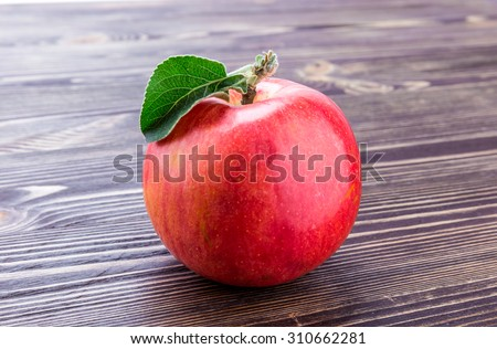 apple flowers and ripe red apples on a wooden background closeup - stock photo