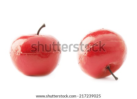 Apple fruit artificial plastic decoration isolated over the white background, set of two foreshortenings