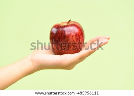 Apple fruit holding by hand