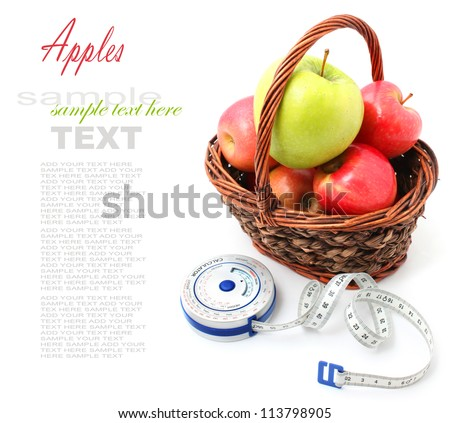 Apple  in a basket with measuring tape on white background - stock photo