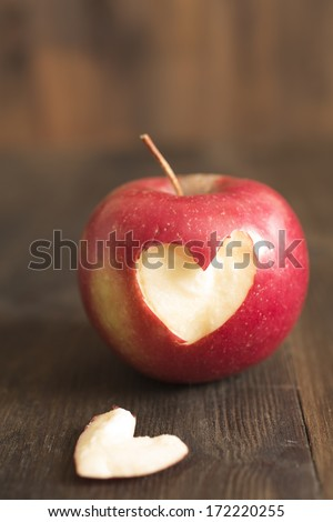 apple in close up with piece in heart shape  - stock photo