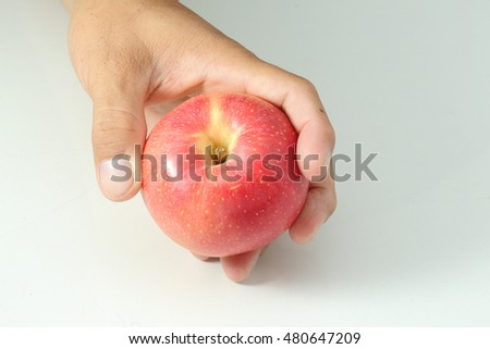 Apple in hand for you. Free space for text.