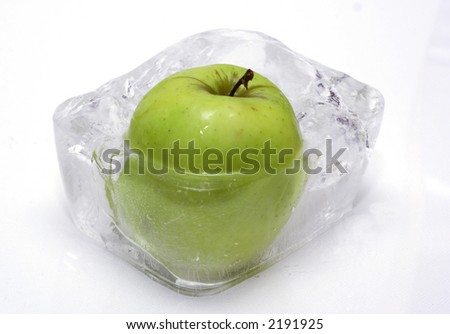 Apple in ice cube - stock photo