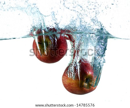 Apple in water - stock photo