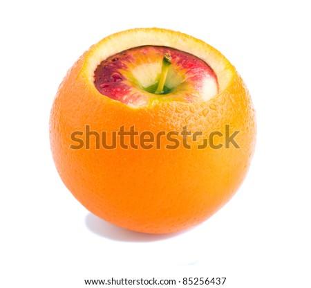 apple inside orange - stock photo