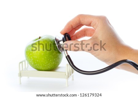 Apple is examined with stethoscope in hospital bed