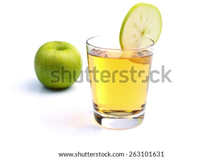 apple juice and apples on white - stock photo