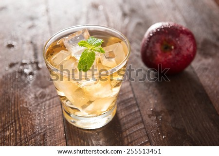 apple juice and apples on wooden table.  - stock photo