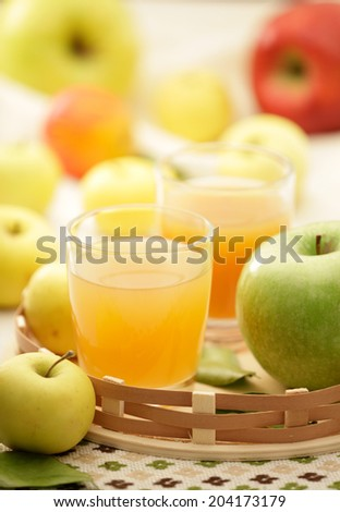 Apple juice and fresh green, red and yellow apples - stock photo