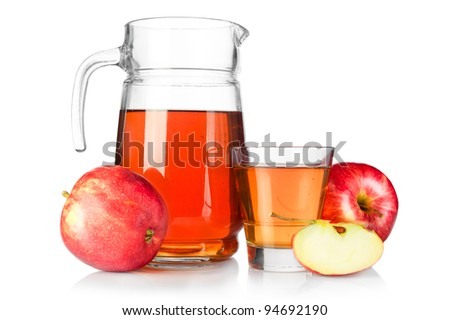 Apple juice. Fresh ripe apples and glass jar of juice isolated on white background - stock photo