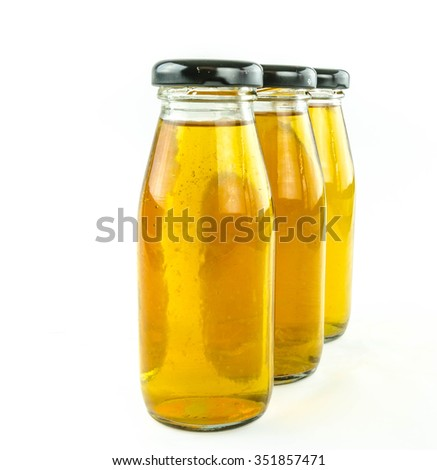 Apple juice in a bottle on a white background.