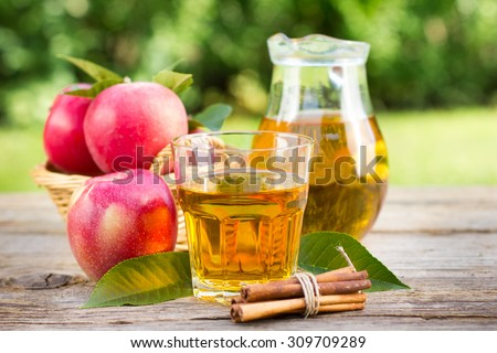 Apple juice in the glass and pitcher - stock photo