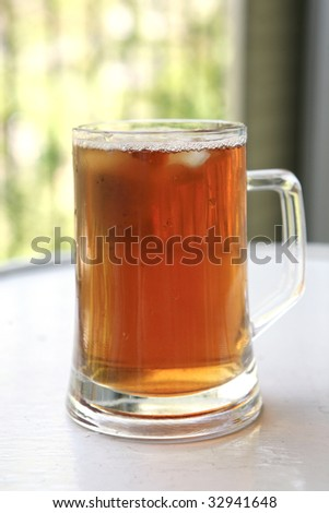 apple juice inside big glass on white table - stock photo
