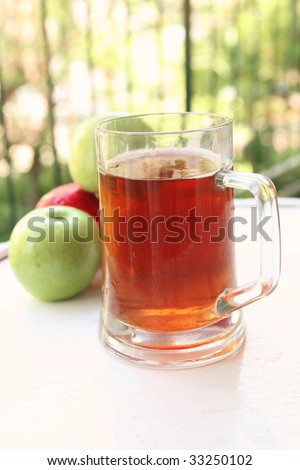 apple juice inside big glass with raw apples - stock photo